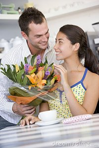 man-giving-woman-bouquet-flowers-4779623